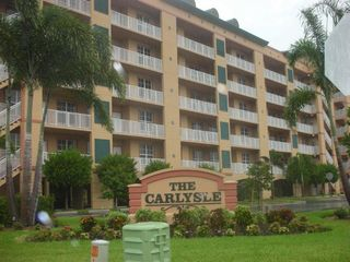 Carlyle 8 sign and full building